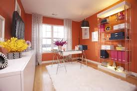 consider a bright yellow orange or red paint color keep the rest of the design somewhat neutral to help balance the look bright home office design