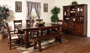 wonderful rectangular table that features your choice of seating inclunding bench style