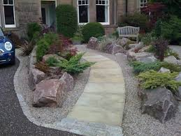 Simple Rock Garden with Decorative Flower Bed: Driveway With Contemporary Large  Rock Garden Flower Bed