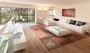 rug under coffee table. designs ideas:small living room with round gray rug under modern chairs also ottoman coffee table