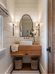Example of a small country dark wood floor and brown floor powder room  design in Other
