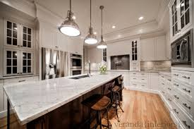 kitchen design with creamy white kitchen cabinets painted benjamin moore white dove coffee stained oak kitchen island river white granite countertops