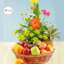 Assorted collection of seasonal flowers with fresh fruits arranged in a decorative  basket is a sweet