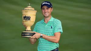 justin thomas poses with the gary player cup after winning the world golf chionships bridgestone