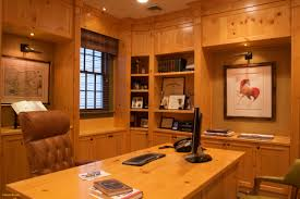 office paneling. Honey Hued Wood Paneling Cabinets And Desk Lend A Warm Serenity To This Office N