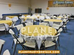 004 round table with white tablecloth and yellow
