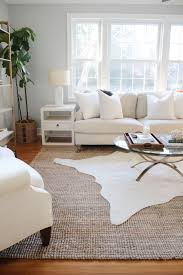 this layering trend is going to take over living rooms in 2017 cowhide rug ikea