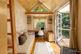 Woman Living Simply In Off Grid Tiny Home On Wheels - Tiny house on wheels interior