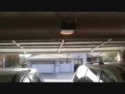 how to adjust garage door openerhow to adjust an automatic garage door opener  YouTube