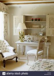 Small White Bedroom Chair Wooden Shutters On Alcove Shelving Above Small White Table And