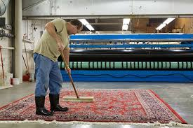each rug is meticulously brushed to set the pile before drying