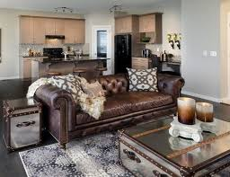 brown leather sofa chesterfield living room coffee table chest mirrored surface