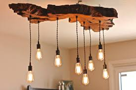 rustic lighting fixtures chandeliers. olive wood liveedge light fixture by 7mwoodworking on etsy wooden chandelierindustrial chandelierdining lightingrustic rustic lighting fixtures chandeliers