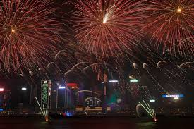 fireworks explode over victoria harbour to celebrate the new year s eve in hong kong early sunday jan 1 2017 ap photo vincent yu