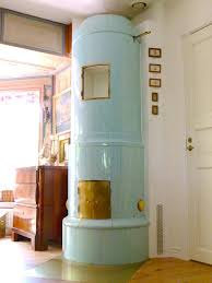 Blue Beauty Cylindrical Stove With Antique Brass Doors