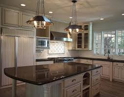 view full size u shaped kitchen features tan cabinets paired with black granite countertops