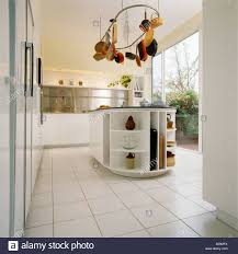 white tile floor kitchen. Simple White Modern White Kitchen With Tiled Floor And Hanging Pan Rack Above  Island Unit In White Tile Floor Kitchen