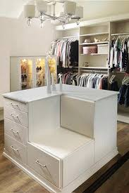 Closet Ideas Surrounding a Closet Island & the Love of Shoes Make Footwear  the Focal Point of This Custom Dressing Room