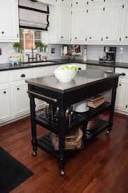 choosing the moveable kitchen islands. Smaller White Kitchen With Dark Portable Island On Wheels. Good Use Of High Cabinets. Choosing The Moveable Islands E