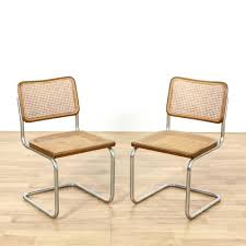 This pair of Marcel Breuer Cesca style chairs are featured in a durable  tubular metal with