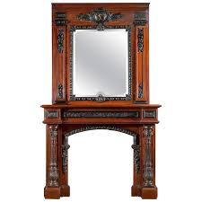 rosewood and ebony antique fireplace mantel in the french baroque manner for