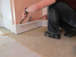 remove a tile floor and underlayment