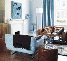 Light blue and brown living room with blue armchair and brown sofa