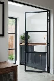 black metal frame glass doors for the kitchen nook