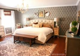 A Gray DIY Stenciled Accent Wall In A Master Bedroom Using The Marrakech  Trellis Stencil From