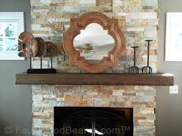 fireplace mantels with a distressed look add a rustic quality to the design