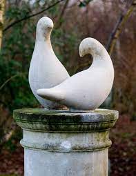 dove statues pair new england garden