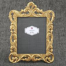 our frame is crafted from poly resin and features a lavish openwork border it holds a standard 8 x 10 vertical photo behind a glass front window
