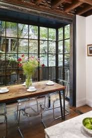 for dinner with a view floor to ceiling bay windows dining room inspiration beautiful though clear chairs are not flattering to anyone s tush