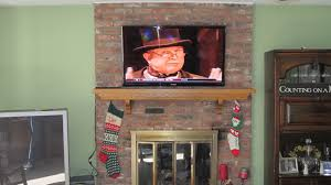 interior wooden fireplace mantel design ideas with mounting tv with mounting tv above brick fireplace