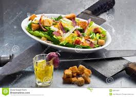 caesar salad dressing stabbed.  Dressing Caesar Salad  Original Version With Egg Dressing And Crunchy Bacon Topping  On A Plate Set Three Butchers Knives Symbolizing The Stabbing Of Julius  On Salad Dressing Stabbed L