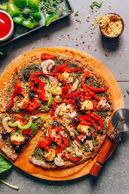 sliced vegan gluten free pizza using our cauliflower pizza crust recipe