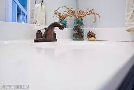 diy painted bathroom sink and counter i m flying south featured on remodelaholic