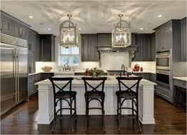 lovely kitchen white arabesque tile pattern backsplash dark gray painted walnut cabinet island laminate wood floors black height counter bar stools brass
