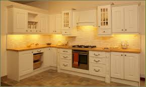 backsplash designs. Impressive Kitchen Backsplash Ideas Cream And White Colored Cabinets With Towel Side Andd Lamps Pictures Designs