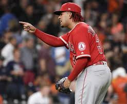 los angeles angels relief pitcher keynan middleton celebrates the team s win in a baseball game against