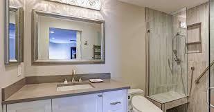 contemporary bathroom design boasts white bathroom cabinet with taupe quartz countertop silver beaded mirror and