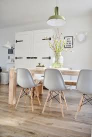eames chairs and sleek unstained solid timber table with farmhouse style pantry stunning kitchen dining décor idea