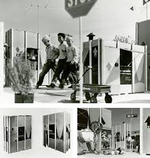 the eames office. photos labeled carton city usa show sunkissed kids navigating eames alley and the office f