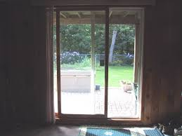 vintage glass sliding glass door with wooden frame also sliding curtain and blue floor mat