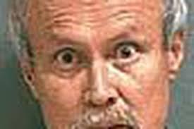 Dentist arrested in stabbing after wild ride on SUV - Deseret News