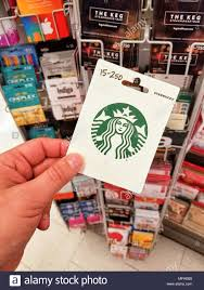 montreal canada march 31 2018 a hand holding starbucks gift card starbucks corporation is an american coffee pany and coffeehouse chain