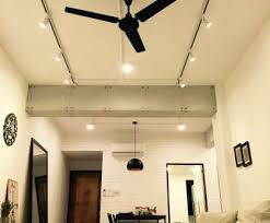 bare wire track lighting cleaver living area shot from floor concrete finished beams