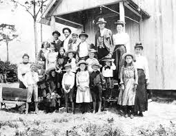 Florida Memory • Children with their teacher in front of schoolhouse -  Courtenay, Florida.
