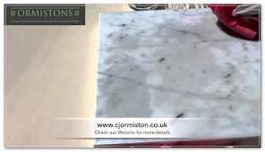 how to clean water stains on marble countertops