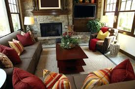 small red living room ideas rustic living room design with brick wall containing a fireplace and television brown sofas are
